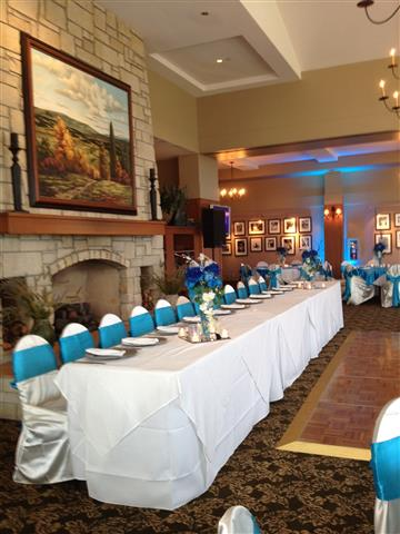 White and blue bridal party table during reception