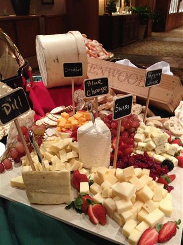 Delicious variety of cheeses placed on table