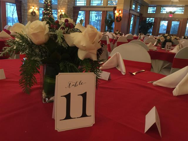 Up close view of table 11 with bouquet of flowers